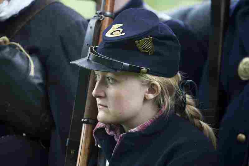 "69th New York Infantry Pvt. ""Chris Smith"" stands in formation with her unit."