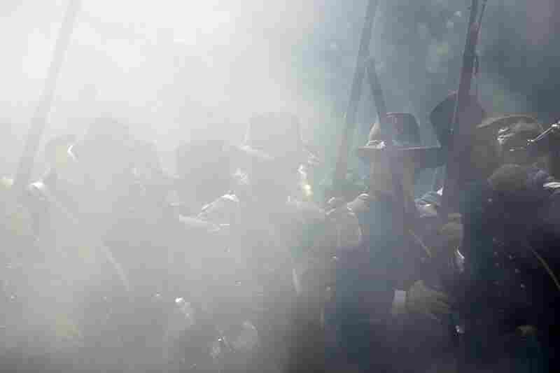 Union re-enactors are shrouded in smoke during a battle.