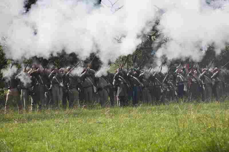 The Confederate Army fires for an audience following a re-enactment for the public at Stanford Hall.