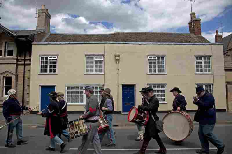 ACWS reenactors carry instruments during the Market Deeping Carnival parade on the Fourth of July. John Fairfield (left), who made some of the drums used at the re-enactment, leads the group.