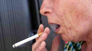 A woman smokes in Miami.