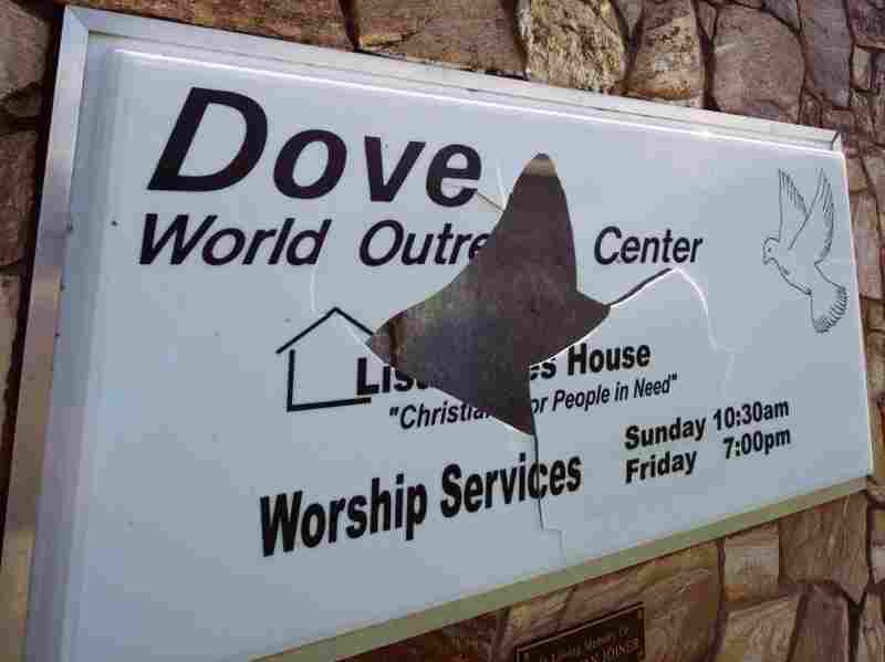 A vandalized sign at the Dove World Outreach Center