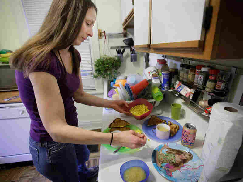 Single mother Lisa Zilligen, who receives food stamps, prepares lunch for her children.
