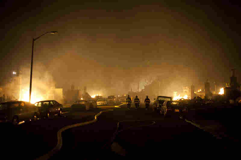 Firefighters walk through smoke during a massive fire in a residential neighborhood Thursday in San Bruno, Calif. A ruptured natural gas line sparked a massive explosion in a neighborhood near San Francisco International Airport.