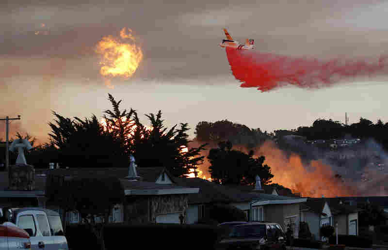 Firefighters from San Bruno and surrounding cities battle the blaze that started on a hillside.