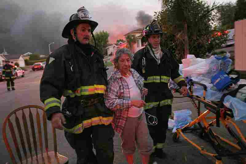 A woman is treated by firemen after the explosion. Hospitals reported receiving about 20 injured patients — several of whom were in critical condition.