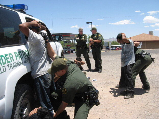 Border patrol agents arrest immigrants in 2007 who had recently crossed the border from Mexico into Nogales, Ariz. Federal programs like Operation Streamline put border-crossers without other prior criminal records through the federal court system.