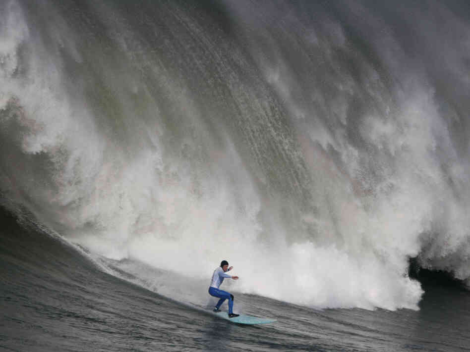 Shane Desmond surfs a wave off the coast of Half Moon Bay, Calif.