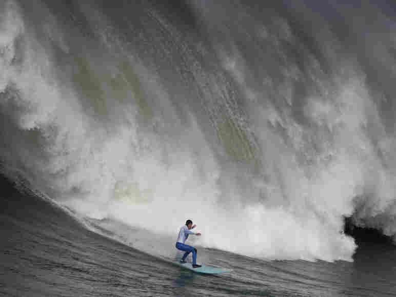 Shane Desmond surfs a wave off the coast of Half Moon Bay, Calif.
