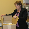 Illinois State Rep. Sandy Cole unpacks in her new office after being evicted from her other office.