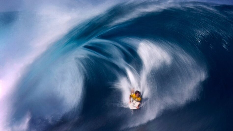 <strong>Surf's Up:</strong> About 70 percent of the Earth's surface is covered by water — and humans have long been fascinated by the mysteries of the ocean — a source of food, transportation ... and fun.  Above, Ryan Hardy of Australia rides  a large wave on the North Shore of Oahu, Hawaii.