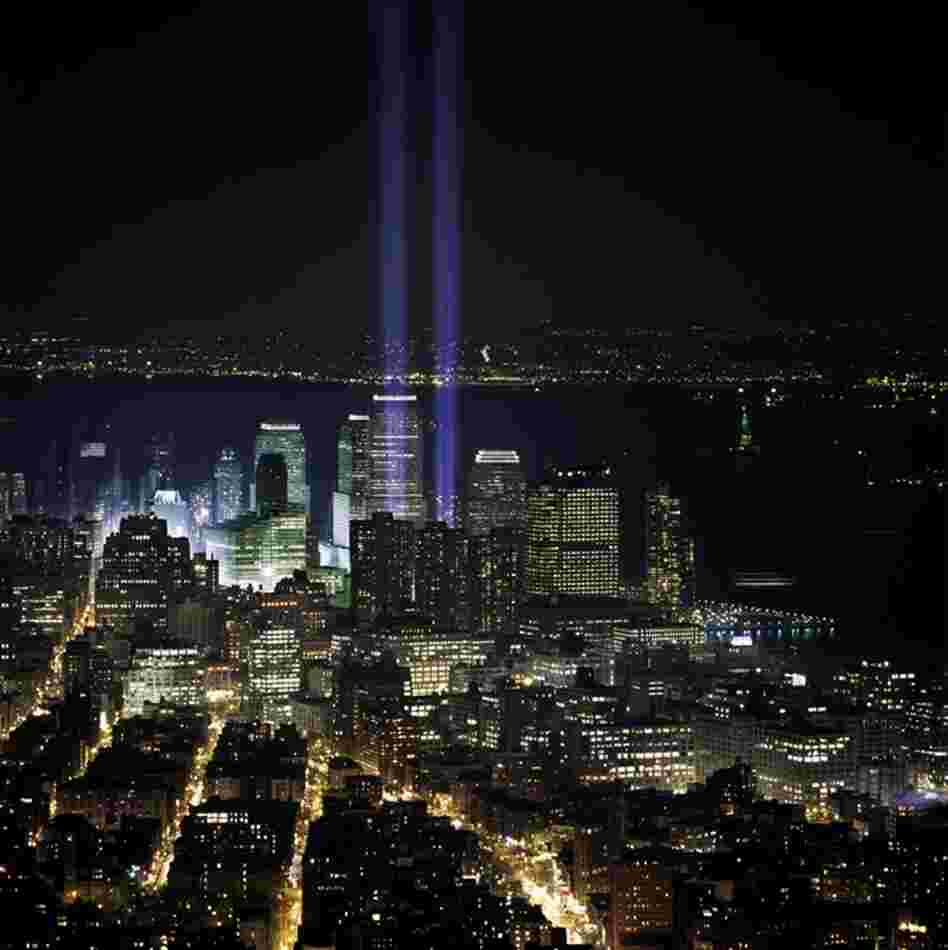 Six months after the fall of the twin towers, two beacons of blue light rise beyond Tribeca as a memorial. March 11, 2002