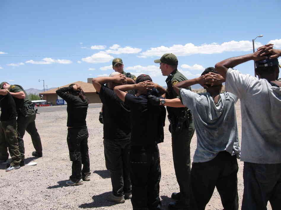 Border Patrol arrests migrants in 2007 after they illegally crossed the border into Nogales, Ariz.