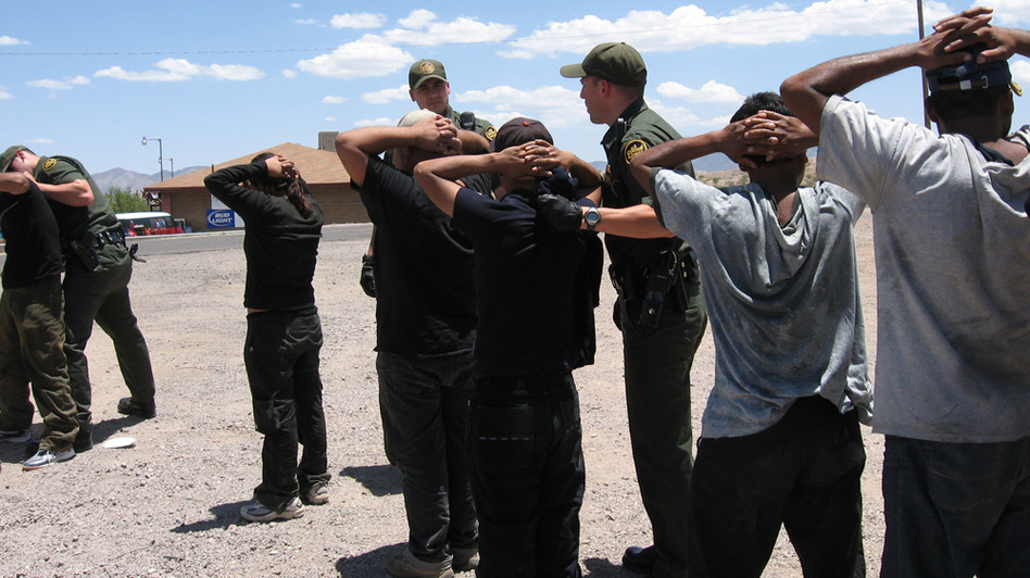 Border Patrol agents arrest migrants in 2007 after they illegally crossed into Nogales, Ariz. Operation Streamline puts such people into federal courts, giving them criminal records. The Border Patrol says the program allows the agency to focus on more serious crime, but federal judges say it causes backups in the system.