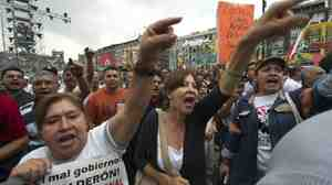 Protesters shout slogans against Mexican President Felipe Calderon.