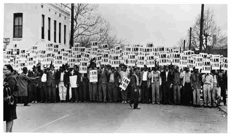One of Withers' most iconic photographs: Sanitation workers assemble in front of Clayborn Temple for a solidarity march, Memphis, Tenn., 1968.