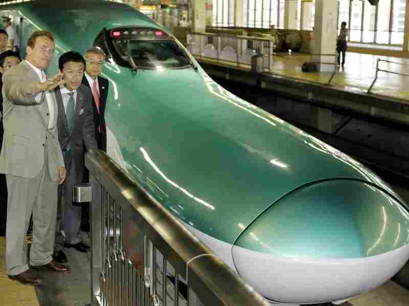 California Gov. Arnold Schwarzenegger inspects Japan's high-speed bullet train in Saitama.