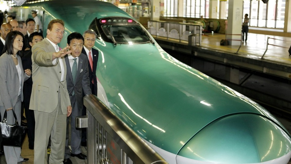 California Gov. Arnold Schwarzenegger (left) inspects Japan's high-speed-train operations in Saitama, as his home state looks to modernize its rail system. California is among the states that received $8 billion in stimulus money for high-speed rail.