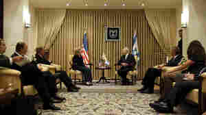 U.S. Secretary of State Hillary Clinton meets with Israeli President Shimon Peres.