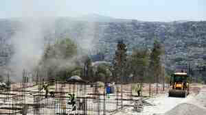 Construction crews work at the site of Palestinian security forces facilities Thursday in the West Bank.