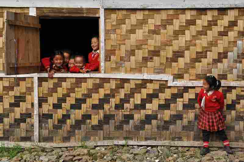 Winner, Goal 2: Children take a break from class at their newly established primary school in northeastern India. About 10 years ago, primary education was not prevalent here, as it is today.