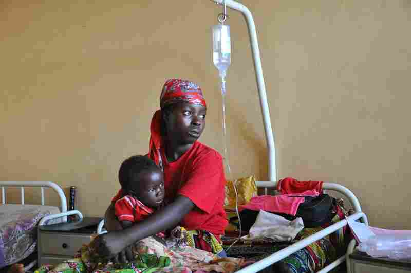 Goal 5: Improve maternal health Winner: A mother and child recover from malaria in a hospital in Burundi. The government provides free health care for pregnant women and children under 5.