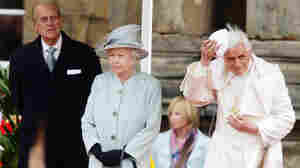 "Pope Benedict XVI replaces his ""zucchetto"" as he meets with Queen Elizabeth II and Prince Philip."