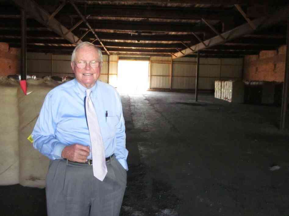 Barry Whitney, descendant of Eli Whitney, stands inside S.M. Whitney Company's cotton warehouse