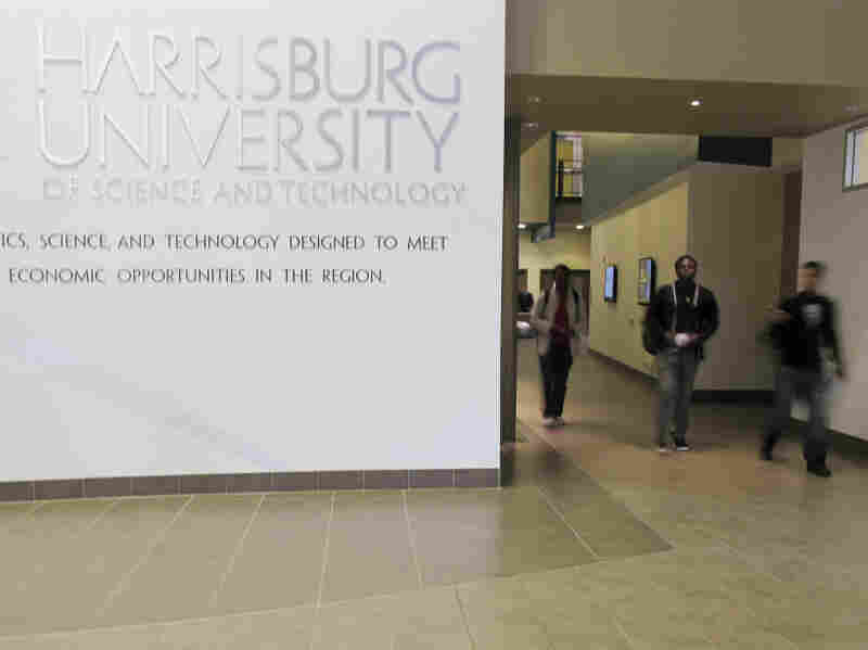 People walk through the atrium of Harrisburg University of Science and Technology in Harrisburg, Pa.