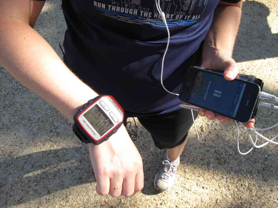 NPR's Tamara Keith shows off her Garmin GPS watch and iPhone running app.
