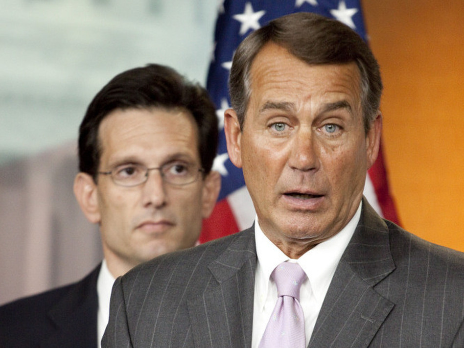 House Minority Leader John Boehner of Ohio (right), accompanied by House Minority Whip Eric Cantor of Virginia, speaks on Capitol Hill in April. Cantor is the leader of the Young Guns movement in the Republican Party, and some Republicans say his group could topple longtime Republicans like Boehner.