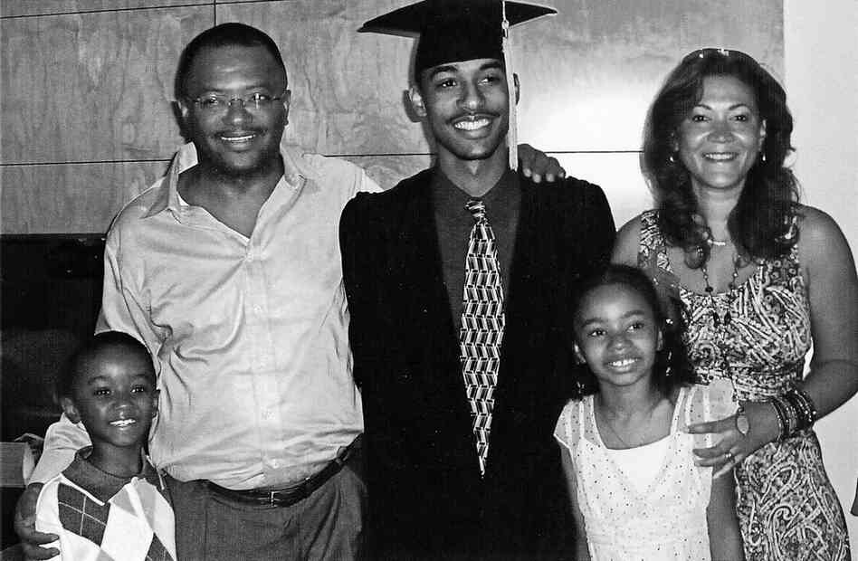 """One of the enduring sorrows of my life,"" Norris writes, ""is that my father never met my husband or my children, pictured here on the day my stepson graduated from college."" From left: son, Norris; husband, Broderick Johnson; stepson, Broddy; daughter, Aja; and Norris."