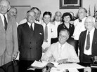 FDR signs Social Security law