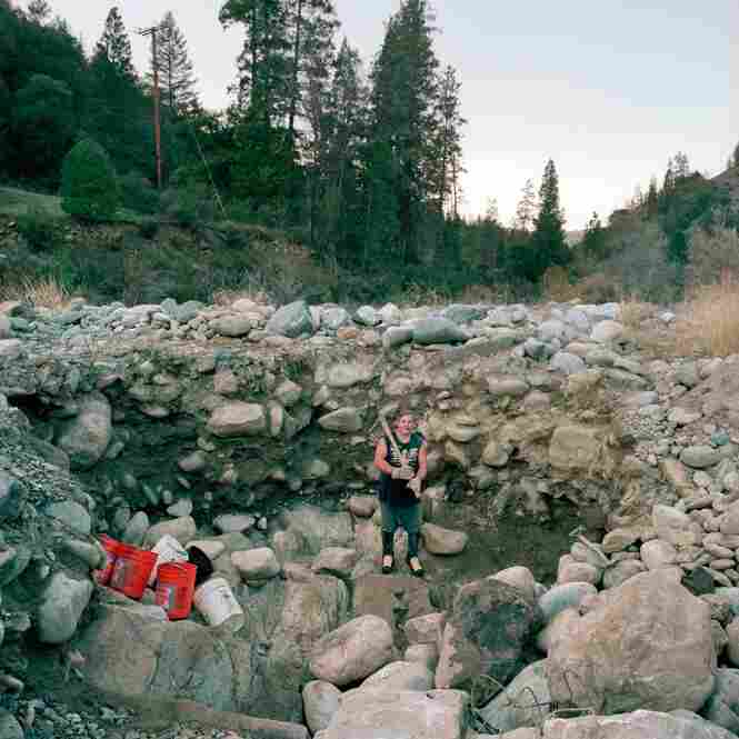 Prospector Avery Rathburn at his digging site along Scott River, Klamath National Forest, Calif.
