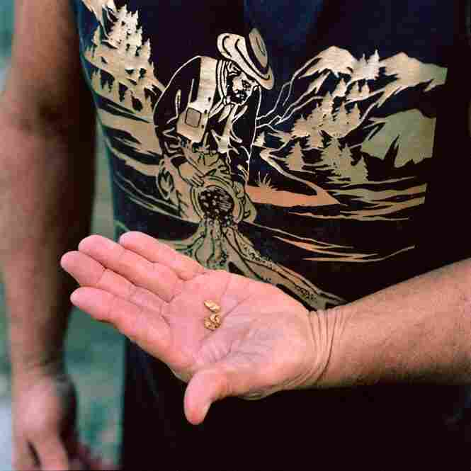 Avery Rathburn shows some gold found in Scott River, Klamath National Forest, Calif.