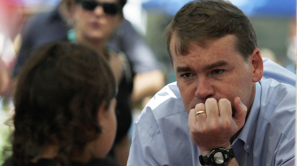 Sen. Michael Bennet (D-CO) visits with a young girl as he campaigns in downtown Colorado Springs, Colo., on Aug. 9. After surviving a tough primary challenge, Bennet is now in a close race with Tea-Party-backed Republican Ken Buck.