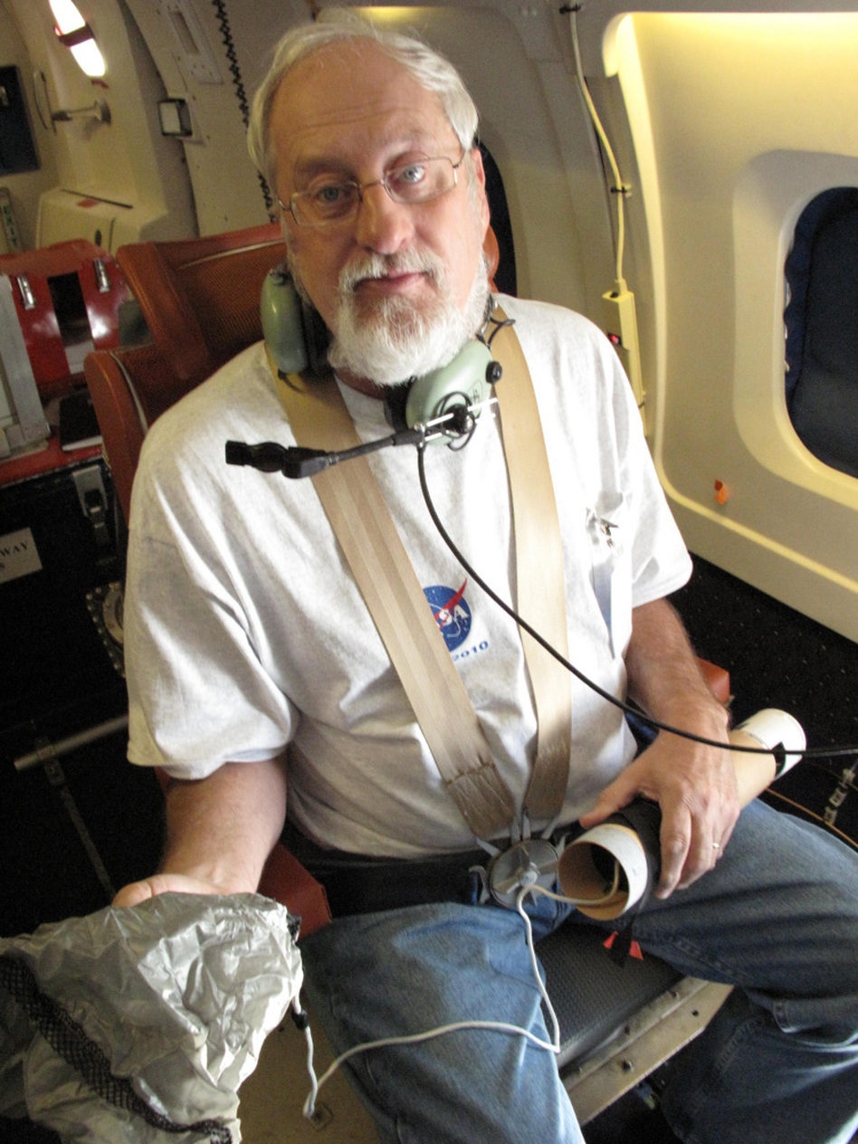 Bob Pasken from Saint Louis University prepares to release a dropsonde into Hurricane Karl while flying above it. The devices relay crucial data about winds, temperature, humidity and pressure back to researchers.