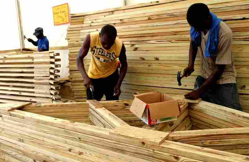 Unlike most current cash-for-work programs in Port-au-Prince, where locals are employed and paid by the hour, Concern Worldwide pays its carpenters according to output.