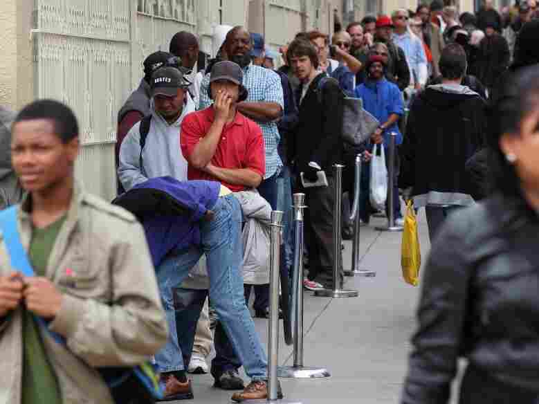 People line up to receive a free meal in San Francisco