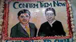A show of support, in cake, for judicial nominees Liu and Chen.