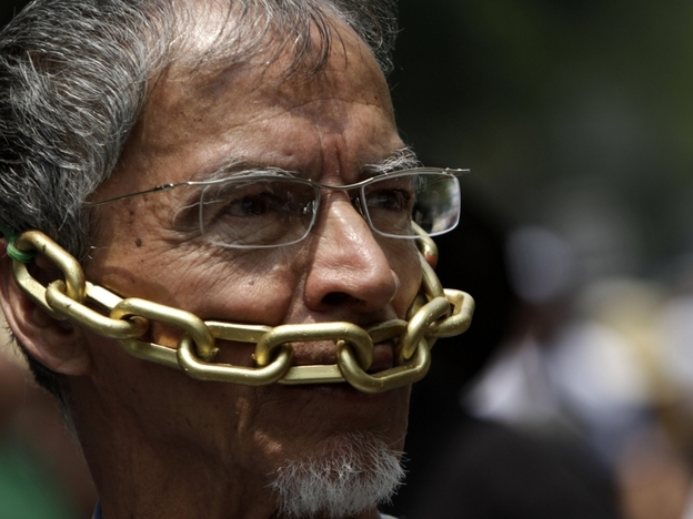 In this Aug. 7 photo, a Mexican journalist protests against the violence against journalists.