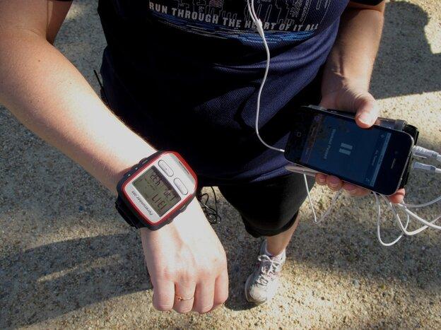 Tamara Keith with iPhone and Garmin watch