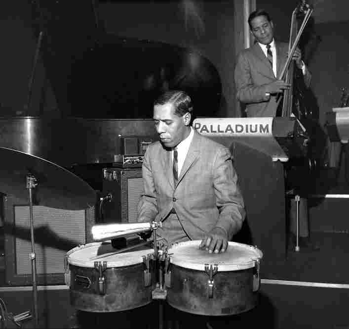 Papi Pagani, the son of Federico, along with Julian Dino with the Tito Rodriguez band at the Palladium Ballroom, New York City, circa 1962. Federico Pagani was a dance promoter who often booked the bands that appeared at the Palladium. Tito Rodriguez was considered one of the Big Three that dominated the Palladium sound, along with the orchestras of Tito Puente and Machito.