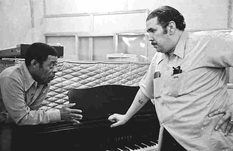 "Bongocero Jose Mangual Sr. and bassist Bobby Rodriguez chat during a break in the recording of Mangual's album ""Buyu"" in New York City, 1977. Both musicians were veterans of many bands including probably the most important band of them all, Machito and His Afro-Cubans."