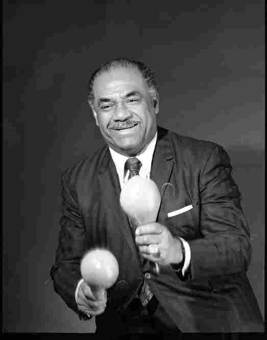 Machito in my basement photo studio/workshop in the 1970s.  Machito liked the plastic maracas that I made because they were loud and he performed in front of a large band.