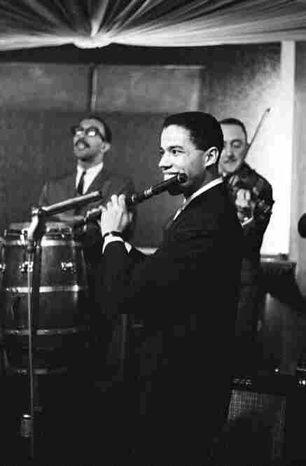 This is an early shot of musician and arranger Johnny Pacheco leading his band at the Palladium Ballroom in New York City in 1962. Pacheco would later go on to become a pivotal figure in the creation of Fania Records, the seminal salsa label.