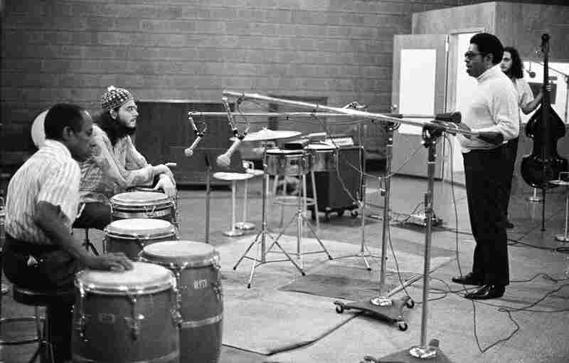 """Carlos """"Patato"""" Valdez (from left), Jerry Gonzalez, Dizzy Gillespie and Andy Gonzalez during recording on the album, Portrait of Jenny at Rudy Van Gelder's studio in Englewood Cliffs, N.J., sometime in the 1970s."""