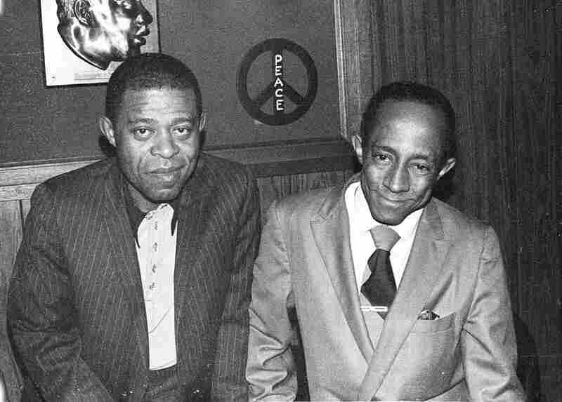 "Jose Mangual Sr. (left) and Carlos ""Patato"" Valdez in a Bronx bar."