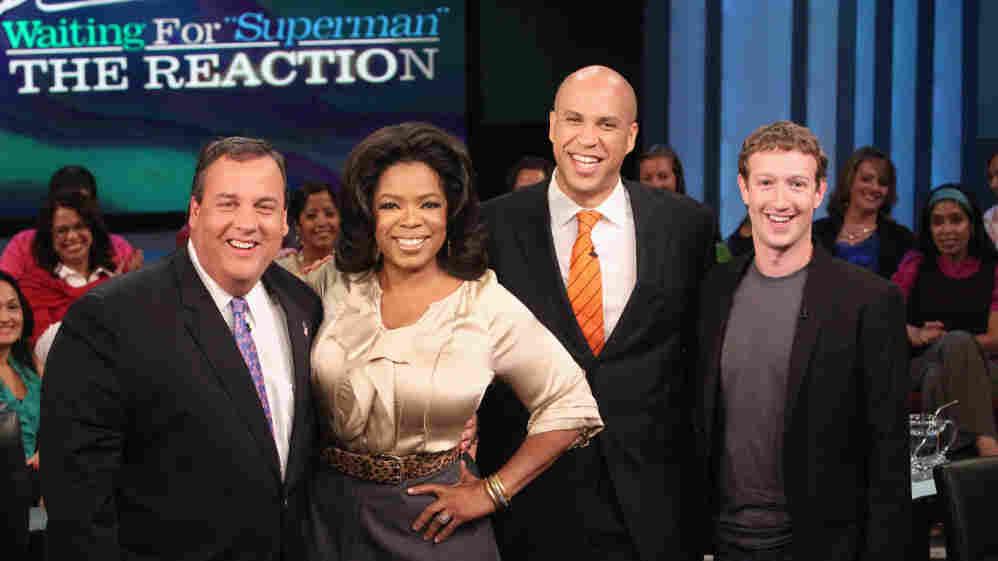From left: N.J. Gov. Chris Christie, Oprah Winfrey, Newark Mayor Cory Booker, Mark Zuckerberg