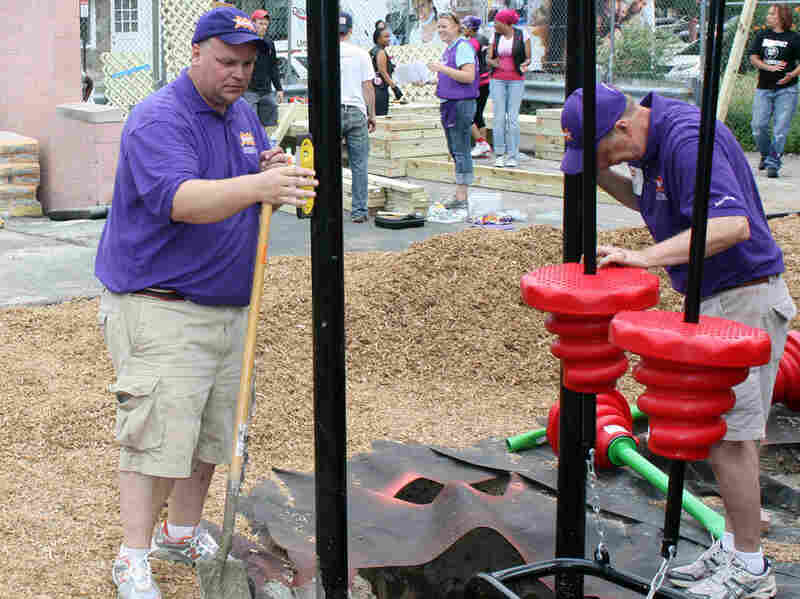 Darell Hammond makes sure supports for a new playground are straight.